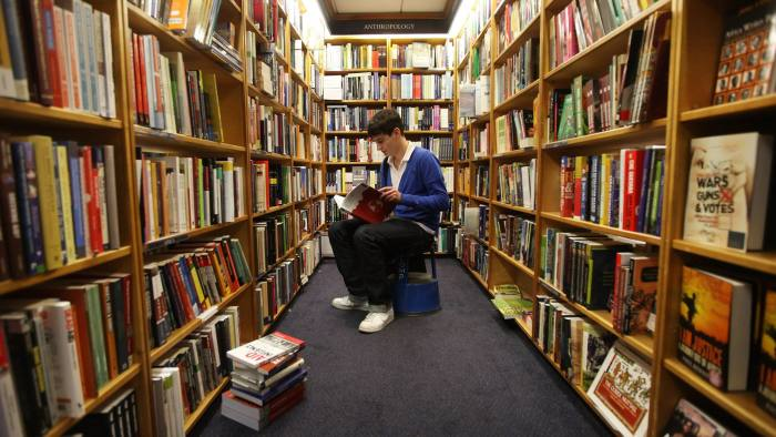 An Oxford student in a Blackwells bookstore