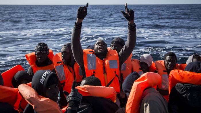 Sub-Saharan migrants react inside a dinghy as they are rescued by members of Proactiva Open Arms NGO at the Mediterranean sea, about 20 miles north of Ra's Tajura, Libya, Thursday, Jan. 12, 2017. About 300 migrants were rescued Tuesday from three dinghies by members of Proactiva Open Arms Spanish NGO and Italian coast guards before transferring them to the Italian coast. (AP Photo/Olmo Calvo)
