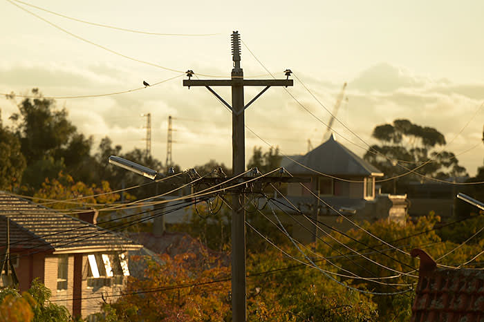 Power lines hang from a utility pole in the suburb of Northcote in Melbourne, Australia. Photographer: Carla Gottgens/Bloomberg
