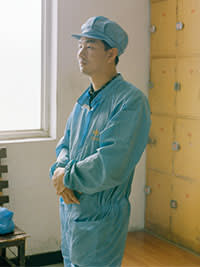 A factory worker at the Jinglong plant