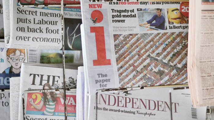 "A new British newspaper known as 'i' is pictured on a news stand in central London, on October 26, 2010. Russian tycoon Alexander Lebedev, who owns three British newspapers, launched the country's first quality daily in 25 years Tuesday in a risky bid to grab more of the ailing British press market. The paper is ""specifically targeted at readers and lapsed readers of quality newspapers,"" according to Lebedev's main national daily, The Independent, which will share editorial staff with the new publication."
