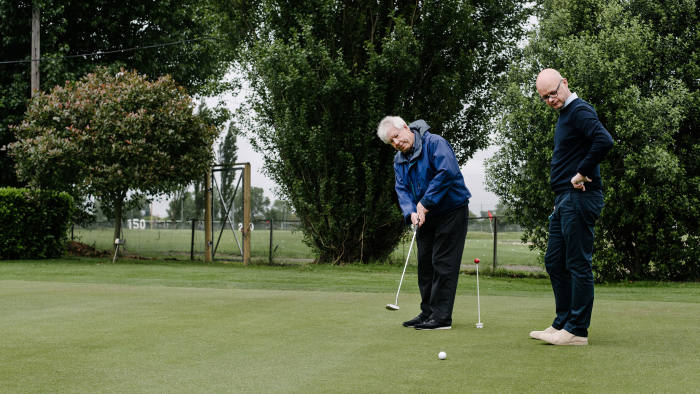 Richard Thaler, left, instructs Jonathan Derbyshire in the unexpectedly complicated pursuit of putting