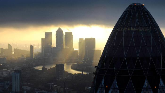 """City jobs...Embargoed to 0001 Monday December 2 File photo dated 25/02/10 of the 'Gherkin' and Canary Wharf at sunrise in the City of London as around 2,500 jobs were created in the City of London in November, the highest number for seven months, a new study has shown. PRESS ASSOCIATION Photo. Issue date: Sunday December 1, 2013. Recruitment firm Astbury Martin said the rise, when vacancies are usually in decline, might show that an increase in City activity was starting to feed through to jobs. Chief operating officer Mark Cameron said: """"There is normally a lull in hiring activity at this time of year, and this is the first time since 2010 that we have seen a reversal of that trend. This is the long-awaited positive indicator that the City has been hoping for."""" See PA story INDUSTRY City. Photo credit should read: Stefan Rousseau/PA Wire"""