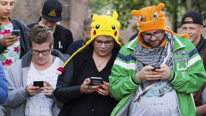 epa05423852 (FILE) A file picture dated 11 July 2016 shows people playing the new game 'Pokemon Go' on their smartphone in Leerdam, The Netherlands. According to reports, shares of Japanese multinational consumer electronics and software company Nintendo soared by 16 percent at the Tokyo Stock Exchange on 14 July 2016, given to the success of its new smartphone game 'Pokemon Go.' The shares of the company, which is headquartered in Kyoto, Japan, reached 244 US dollar during the first half of the trading day at the Tokyo exchange, media added. Pokemon Go, a Global Positioning System (GPS) based augmented reality mobile game, launched first on 06 July in the US. EPA/PIROSCHKA VAN DE WOUW