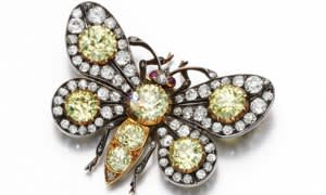 Yellow and white diamond butterfly brooch (guide price £25,000 - £35,000)