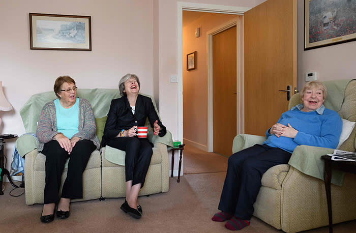 British Prime Minister Theresa May (C) chats with residents Val Lay (L) and Rita Bowden during a visit to a housing estate on November 16, 2017 in London, England. British Prime Minister May has pledged to take personal charge of Government plans to address the current housing problem. / AFP PHOTO / POOL / Leon NealLEON NEAL/AFP/Getty Images