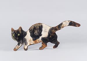 A cat-shaped bird scarer (1900-1925)