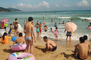 Tourists in Sanya, Hainan, also home to one of China's naval bases