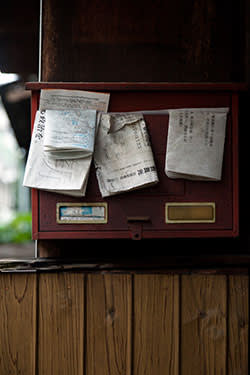 Mail left uncollected at an abandoned home
