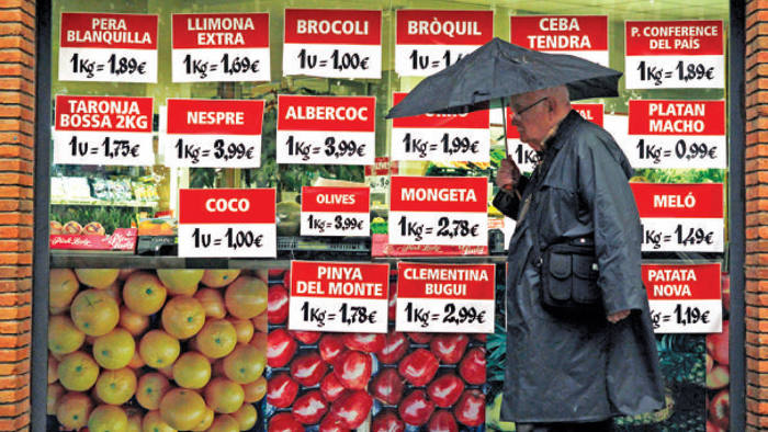 A grocer's window display in Barcelona, where shopkeepers complain of falling prices