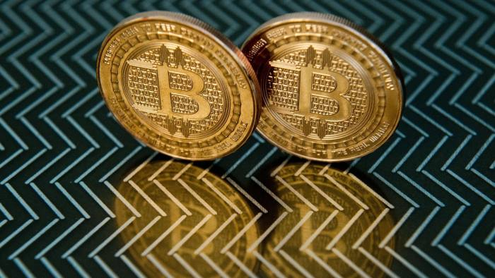 This June 17, 2014 photo taken in Washington, DC shows bitcoin medals. Bitcoin uses peer-to-peer technology to operate with no central authority or banks; managing transactions and the issuing of bitcoins is carried out collectively by the network. AFP PHOTO / Karen BLEIER (Photo credit should read KAREN BLEIER/AFP/Getty Images)