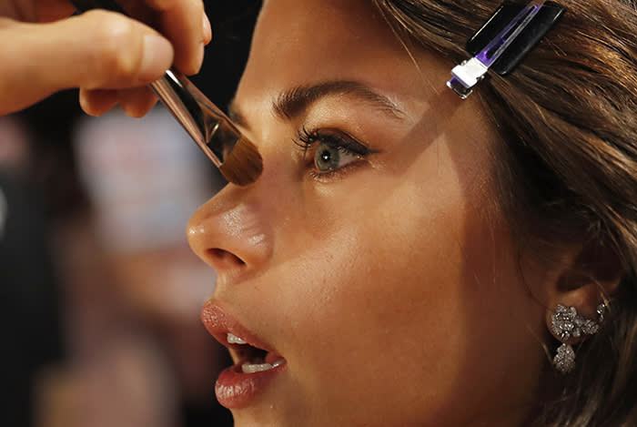 Model Georgia Fowler of New Zealand is made up at backstage before the Victoria's Secret fashion show inside the Mercedes-Benz Arena in Shanghai, China, Monday, Nov. 20, 2017. The Victoria's Secret fashion show takes place in Shanghai on Monday with performances from Singer Harry Styles and R&B star Miguel. (AP Photo/Andy Wong)