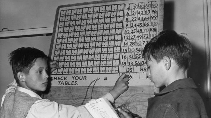 boys using a sum checking machine