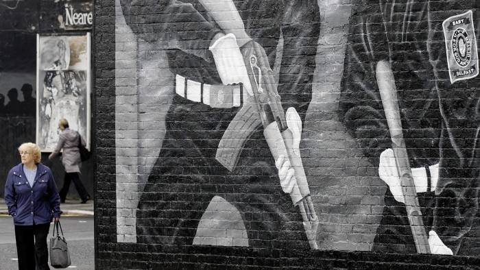A mural showing two Ulster Voluteer Force members covers a wall on Wednesday, June 22, 2011, on the mainly Protestant Newtownards Road area of East Belfast, Northern Ireland, after overnight sectarian violence in the area. Police said about 400 people were involved in last night's unrest in the Short Strand, a small Catholic community in a predominantly Protestant area of east Belfast. Local police commanders blame members of the East Belfast UVF for the unrest. (AP Photo/Peter Morrison)