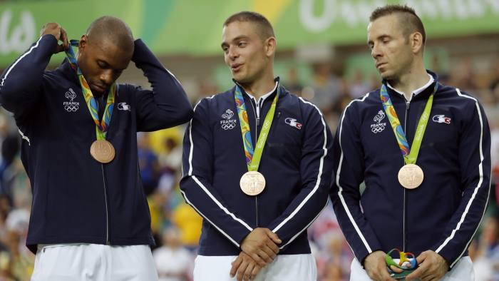 CORRECTS SILVER MEDALISTS TO BRONZE MEDALISTS - French bronze medalists, from left, Gregory Bauge, Michael D'Almeida and Francois Pervis stand on the podium of the men's team sprint finals at the Rio Olympic Velodrome during the 2016 Summer Olympics in Rio de Janeiro, Brazil, Thursday, Aug. 11, 2016. (AP Photo/Patrick Semansky)