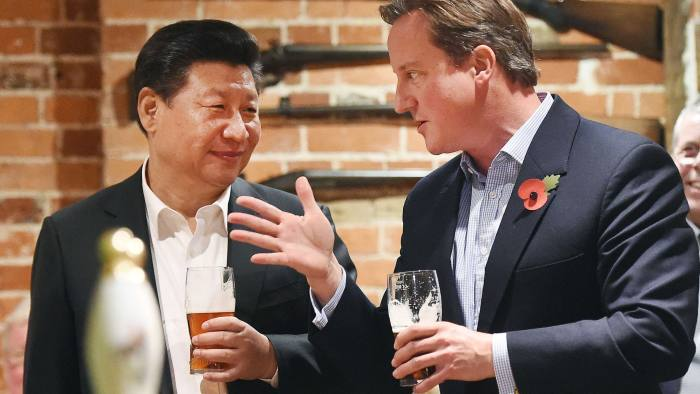 British Prime Minister David Cameron (R) and Chinese President Xi Jinping talk as they drink a pint of peer at a pub in Princess Risborough near Chequers, northwest of London, on October 22, 2015. The two leaders met for talks and dinner during a state visit hailed as a landmark by both China and Britain. AFP PHOTO / POOL / ANDY RAINANDY RAIN/AFP/Getty Images