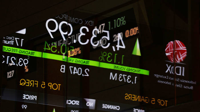 An electronic board displaying the Jakarta Composite Index figure is reflected on a glass window inside the Indonesia Stock Exchange (IDX) in Jakarta, Indonesia, on Thursday, Dec. 17, 2015. Stocks and the dollar climbed, while Treasuries clawed back some gains as the first U.S. interest-rate increase in almost a decade was welcomed across Asian markets. Photographer: Dimas Ardian/Bloomberg