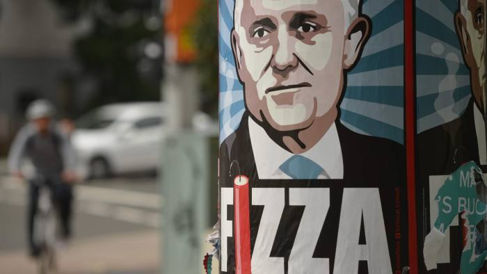 """A poster of embattled Australian Prime Minister Malcolm Turnbull created by Sydney artist Michael Agzarian is seen on a street in Sydney on July 6, 2016. Turnbull's conservative coalition seemed """"absolutely certain"""" to emerge as frontrunner following the general election, a leading analyst predicted and may even secure a majority. / AFP PHOTO / PETER PARKS / RESTRICTED TO EDITORIAL USE, MANDATORY MENTION OF THE ARTIST UPON PUBLICATION, TO ILLUSTRATE THE EVENT AS SPECIFIED IN THE CAPTIONPETER PARKS/AFP/Getty Images"""
