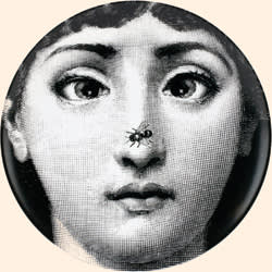 A Fornasetti plate featuring Lina Cavalieri, an Italian opera singer