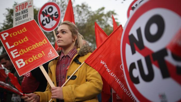 LONDON, ENGLAND - OCTOBER 20:  A woman participates in a TUC march in protest against the government's austerity measures on the Embankment on October 20, 2012 in London, England. Thousands of people are taking part in the Trades Union Congress (TUC) organised anti-cuts march that ends with a rally in Hyde Park, where Labour leader Ed Miliband is scheduled to address the demonstrators.  (Photo by Dan Kitwood/Getty Images)