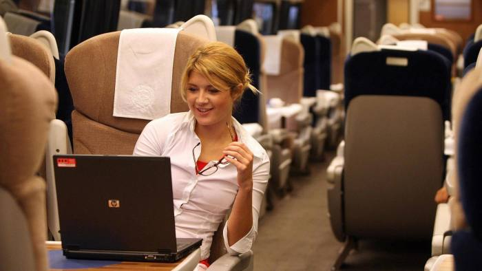 Commuter using Wifi on a train