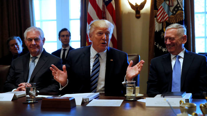 """President Trump with secretary of state Rex Tillerson (left) and defence secretary James Mattis, part of the """"axis of adults"""" meant to keep Trump in check, pictured at the White House in March"""