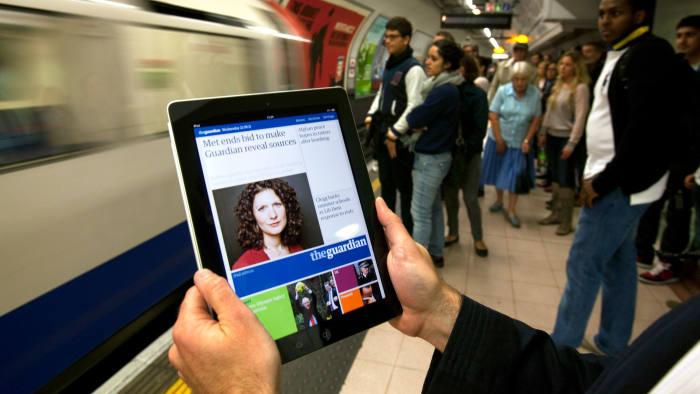 New Guardian iPad app. In the underground. Photograph: Graham Turner.
