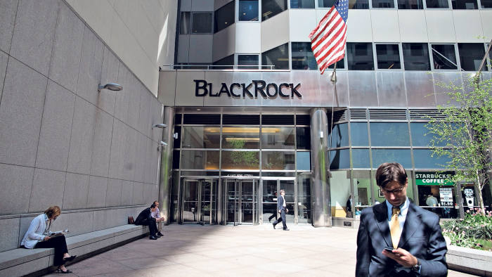 A U.S. flag flies outside the headquarters of BlackRock Inc. in New York, U.S., on Tuesday, April 20, 2010.