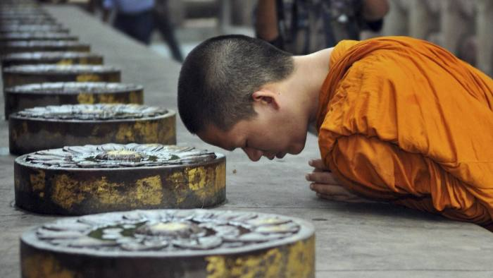 A Buddhist monk offers prayers a day after a series of explosions at the Mahabodhi or the Great Awakening Temple, in Bodh Gaya, India