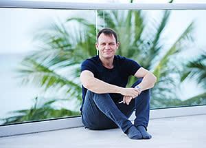 Frank Schilling, founder of Uniregistry, on the veranda of his Grand Cayman condo
