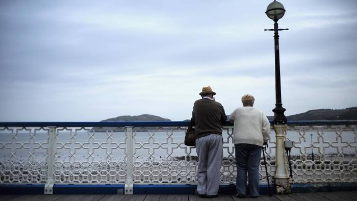 LLANDUDNO, WALES - SEPTEMBER 08: Senior citizens walk along Llandudno Pier on September 8, 2014 in Llandudno, Wales. Britain is facing multiple problems stemming from an increase in the elderly proportion of its population, including increasing health care costs, strains on its social security system, a shortage of senior care workers and challenges to the employment market. (Photo by Christopher Furlong/Getty Images)