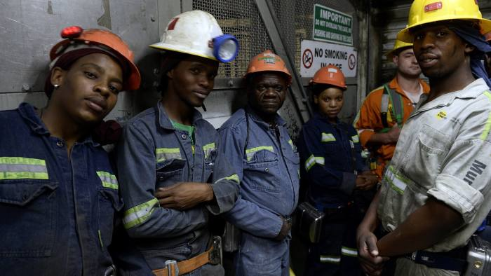 Miners pose as they go back up to the surface at the Cullinan Diamond Mine, 100 kms north-east of Johannesburg, on October 10, 2013 in Cullinan. The mine is famous for large, high quality diamonds and has produced over 750 stones of greater than 100 carats and more than a quarter of all the world's diamonds of greater than 400 carats. It is also the world's only significant source of truly rare and highly valuable blue diamonds. AFP PHOTO / STEPHANE DE SAKUTIN (Photo credit should read STEPHANE DE SAKUTIN/AFP/Getty Images)