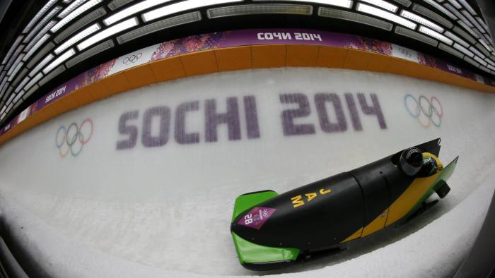 Jamaica's pilot Winston Watts and Marvin Dixon speed down the track during the two-man bobsleigh event at the 2014 Sochi Winter Olympics