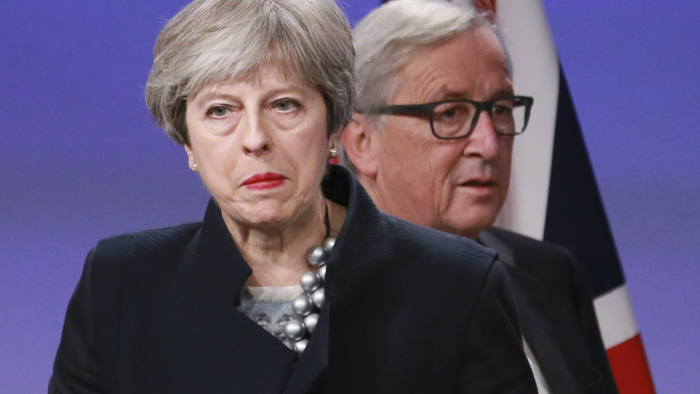 epa06367080 British Prime Minister Theresa May (L) and EU Commissioner President Jean-Claude Juncker (R) prepare to give a press briefing after a meeting at the EU Commission in Brussels, Belgium, 04 December 2017. Reports state that Theresa May stated that Britain has failed to reach an agreement with the EU to move to the next stage of Brexit talks.  EPA/OLIVIER HOSLET