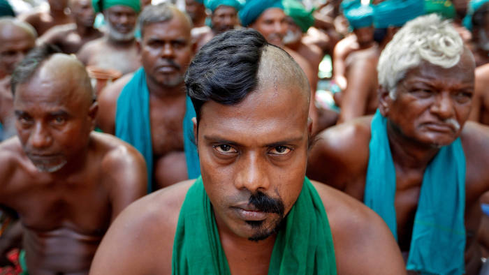 Farmers from the southern state of Tamil Nadu pose half shaved during a protest demanding a drought-relief package from the federal government, in New Delhi, India April 3, 2017. REUTERS/Cathal McNaughton TPX IMAGES OF THE DAY