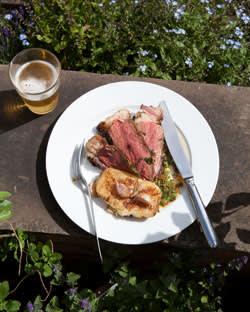 Rare rib of beef with garlic and rosemary potatoes