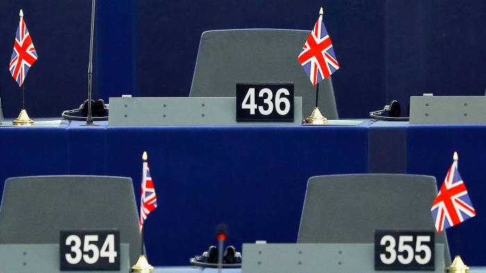 British Union Jack flags are seen on the desks of members of the European parliament ahead of a debate on the upcoming summit and EU referendum in the UK, in Strasbourg, France, February 3, 2016. REUTERS/Vincent Kessler
