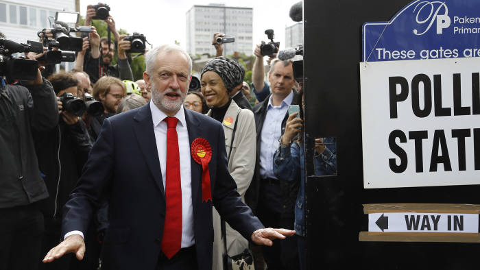 Britain's Labour party leader Jeremy Corbyn gestures after voting in the general election at a polling station in London, Thursday, June 8, 2017. (AP Photo/Frank Augstein)