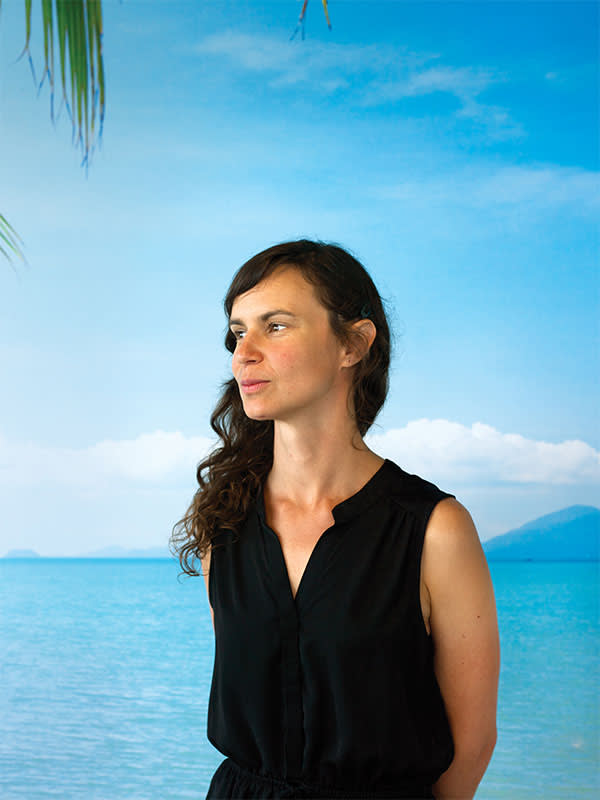 Julia Reisser photographed in the tropical-themed meeting room at Ocean Cleanup's Delft HQ