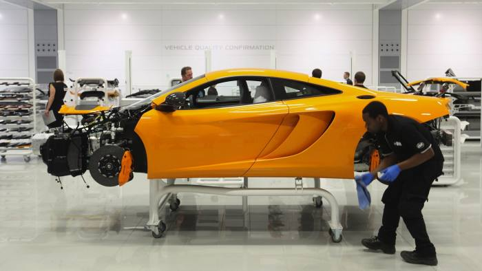 WOKING, ENGLAND - NOVEMBER 17: Workers assemble high performance McLaren MP4-12C sports cars in the Production Centre of the McLaren Technology Centre on November 17, 2011 in Woking, England. The Surrey-based headquarters of the McLaren Group is home to a collection of campanies including McLaren Automotive and the Formaula One constructors McLaren Racing. (Photo by Oli Scarff/Getty Images)