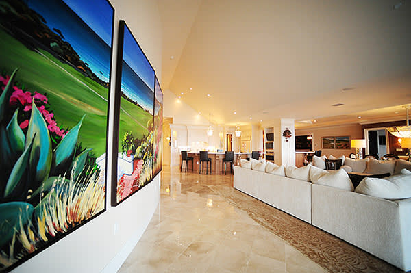 The 'great hall', with a triptych of a Californian beach by French artist Joanny