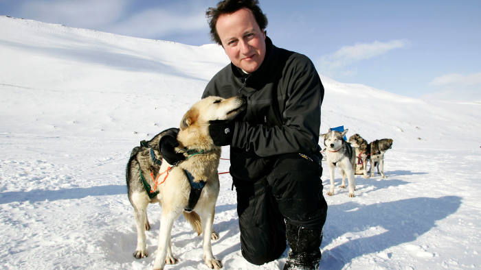 Leader of the Conservative Party David Cameron with Husky dog Troika on the Scott-Turner glacier on the island of Svalbard, Norwa