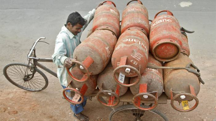 A worker loads Liquefied Petroleum Gas (LPG) cylinders onto his cycle-rickshaw in Kolkata January 17, 2013. Indian Oil Minister Veerappa Moily says LPG cooking gas subsidy changes will increase subsidy burden by 93 billion rupees. REUTERS/Rupak De Chowdhuri (INDIA - Tags: BUSINESS ENERGY) - RTR3CK2F