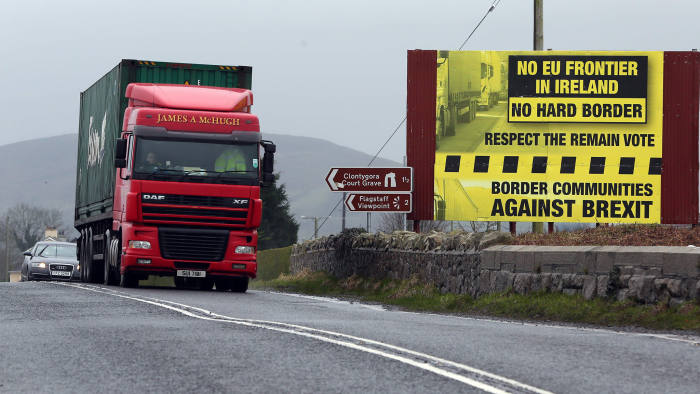 (FILES) This file photo taken on January 30, 2017 shows traffic crossing the border into Northern Ireland from the Irish Republic next to a poster protesting against a hard brexit near Dundalk on January 30, 2017,   		Ireland on December 8, 2017 hailed a historic divorce deal struck in Brussels between Britain and the European Commission that includes guarantees on keeping the Irish border open after Brexit. / AFP PHOTO / Paul FAITHPAUL FAITH/AFP/Getty Images
