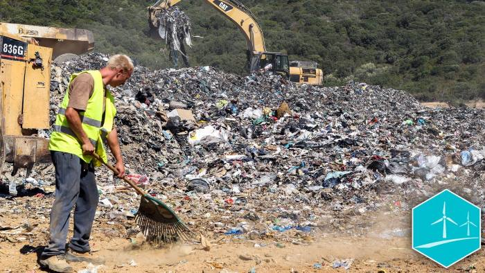 A worker and backhoe loader tractors move garbages and rubbish on a landfill site on September 1, 2015, at Propriano on the French Mediterranean island of Corsica. The island is already drowning under waste and the problem is aggravated by the influx of millions of tourists in summer. AFP PHOTO / PASCAL POCHARD-CASABIANCA TO GO WITH AFP STORY BY PIERRE LANFRANCHI (Photo credit should read PASCAL POCHARD CASABIANCA/AFP/Getty Images)