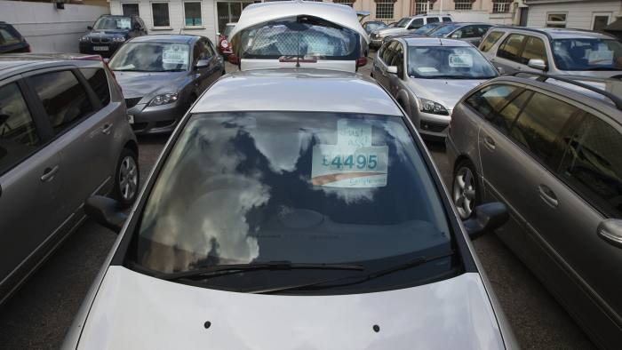A sign advertising the price of a second-hand automobile hangs from the sun-visor of a car parked on the forecourt of an independent dealership in Leigh-on-Sea, U.K., on Monday, April 29, 2013. European car sales are sliding to a 20-year low after German concerns over the debt crisis sent demand plunging last month in the region's biggest economy and removed the main buffer protecting automakers. Photographer: Simon Dawson/Bloomberg