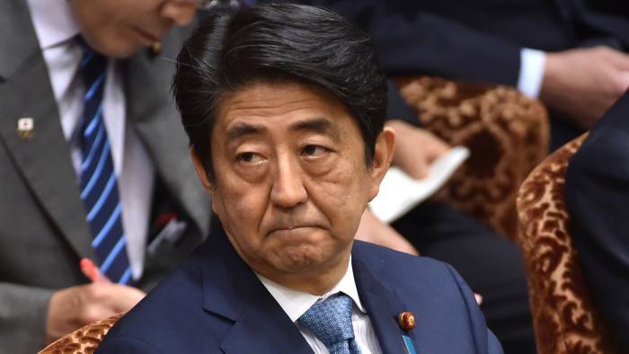 This picture taken on May 13, 2016 shows Japanese Prime Minister Shinzo Abe attending a budget committee session of the House of Councillors in Tokyo. Abe has decided to postpone a sales tax hike a second time, judging that boosting the tariff could hurt the world's third-largest economy, a newspaper said May 14. / AFP / KAZUHIRO NOGI (Photo credit should read KAZUHIRO NOGI/AFP/Getty Images)