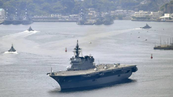 Japan's helicopter carrier Izumo departs Yokosuka port on Monday, May 1, 2017, amid rising tension following missiles tests by North Korea. Japan's navy has dispatched its largest destroyer reportedly tasked with escorting U.S. military ships off the Japanese coast amid heightened tension on the Korean Peninsula. (Ren Onuma/Kyodo News via AP)