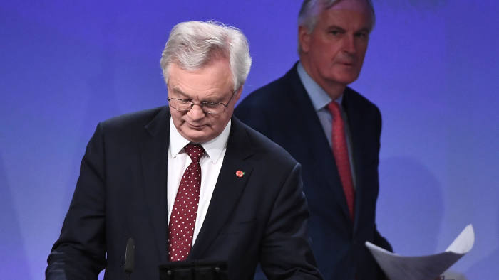 Britain's chief Brexit negotiator David Davis (L) and EU's chief Brexit negotiator Michel Barnier arrive to address the media following a sixth round of Brexit talks at the European Union Commission building in Brussels on November 10, 2017.  / AFP PHOTO / EMMANUEL DUNANDEMMANUEL DUNAND/AFP/Getty Images