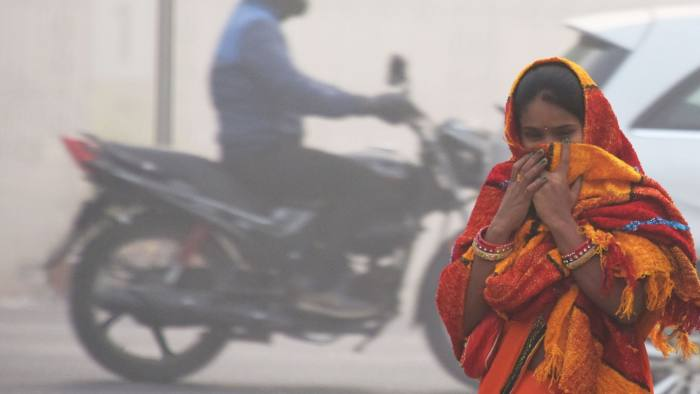 An Indian girl with her face covered walks on a street amid heavy smog in New Delhi on November 13, 2017. Schools reopened in New Delhi on November 13 despite a fresh spike in pollution to emergency levels, drawing protests from parents in the Indian capital who said the move put children's health in jeopardy. / AFP PHOTO / DOMINIQUE FAGETDOMINIQUE FAGET/AFP/Getty Images